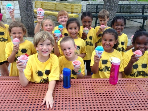 Kids at camp eating snowcones